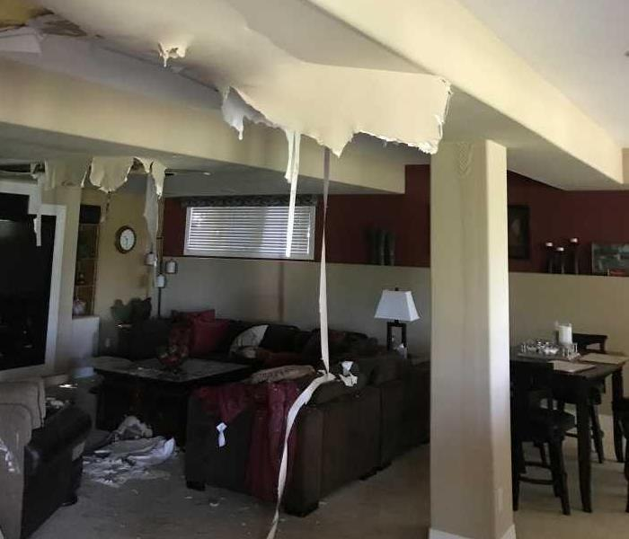 family room in Northglenn ceiling falling in due to to a toilet supply line bursting