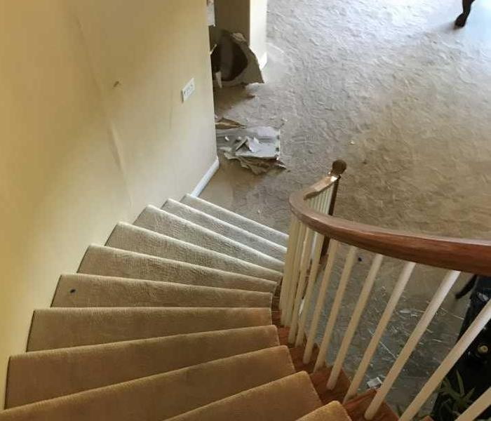Water damage in home on staircase after a severe cold snap caused a frozen pipe to burst in Boulder