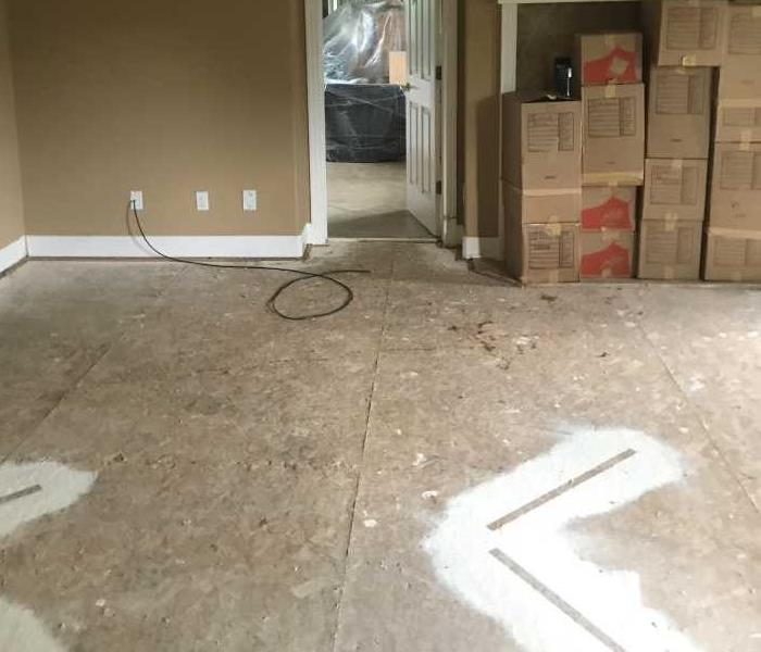 master bedroom floor mitigated after having been flooded with water in Broomfield home