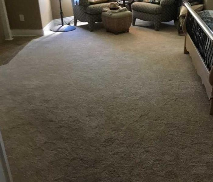 master bedroom carpet flooded with water in Broomfield home