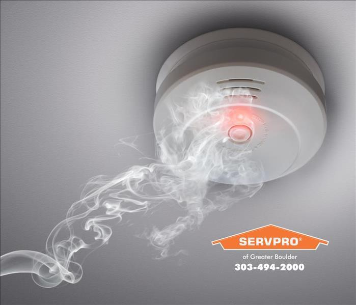 Smoke rising up to a smoke alarm.