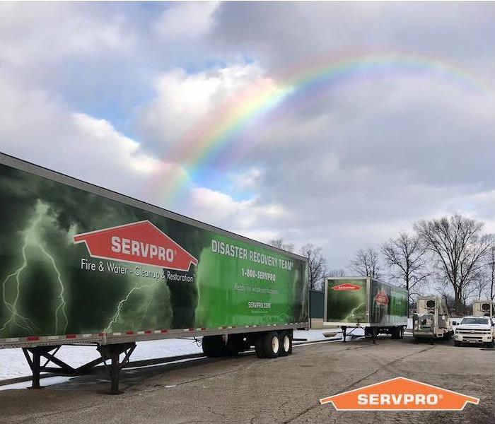 SERVPRO trailers outside with rainbow above it.