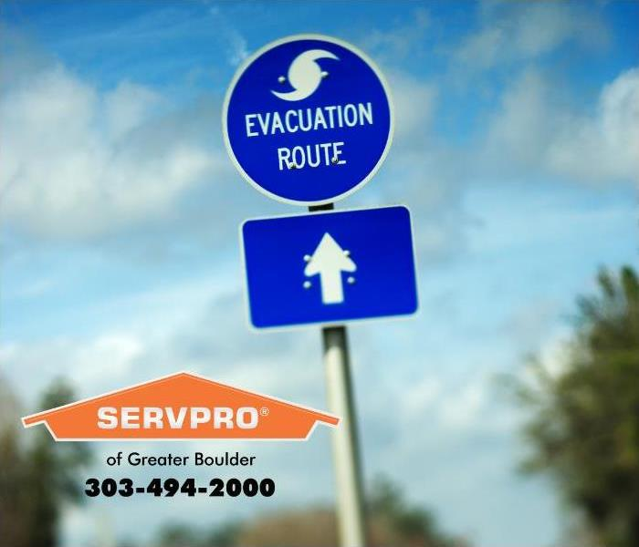 A vehicle sign stating evacuation route