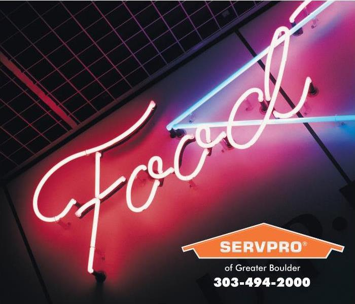 A neon-style food sign is lit showing a restaurant open for business.