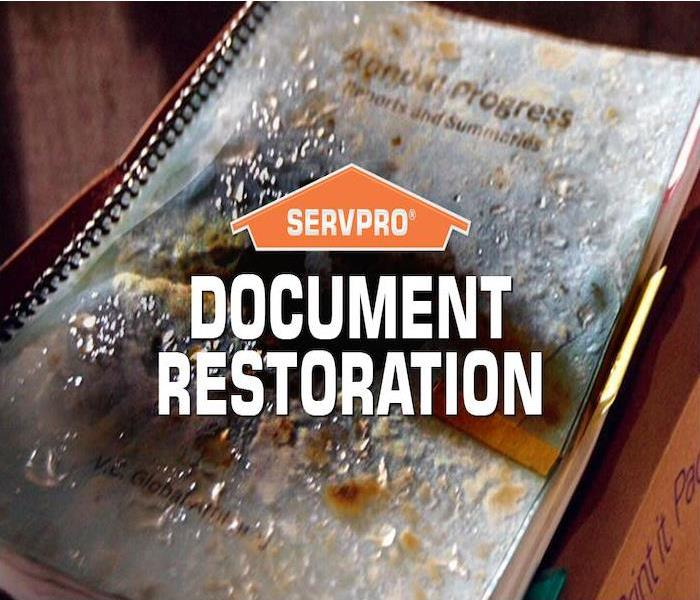 Stack of important documents with water damage and SERVPRO logo.