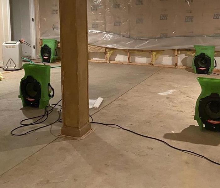 SERVPRO air movers drying out water from storm damage
