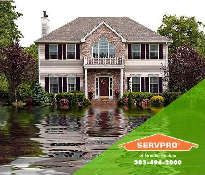 Two-story Ara home surrounded by flood waters.