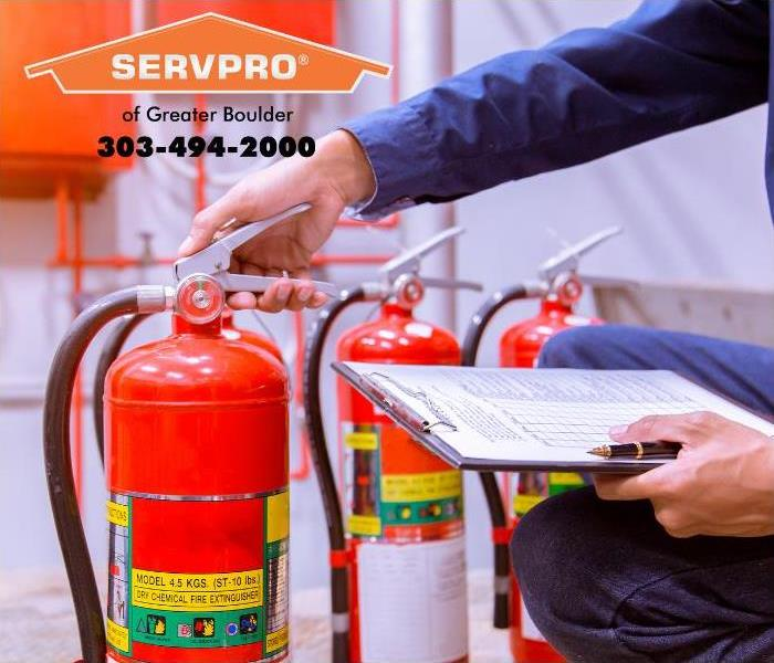 Man double checking fire extinguishers, safety checklist