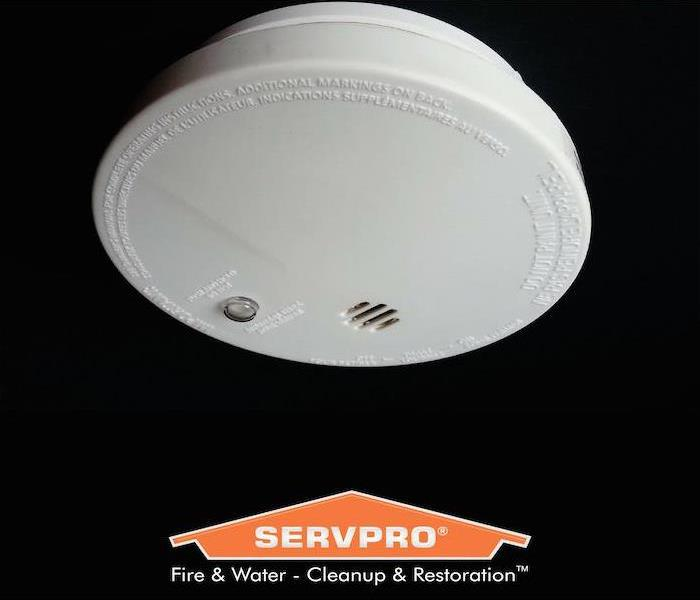 Black background with smoke alarm.