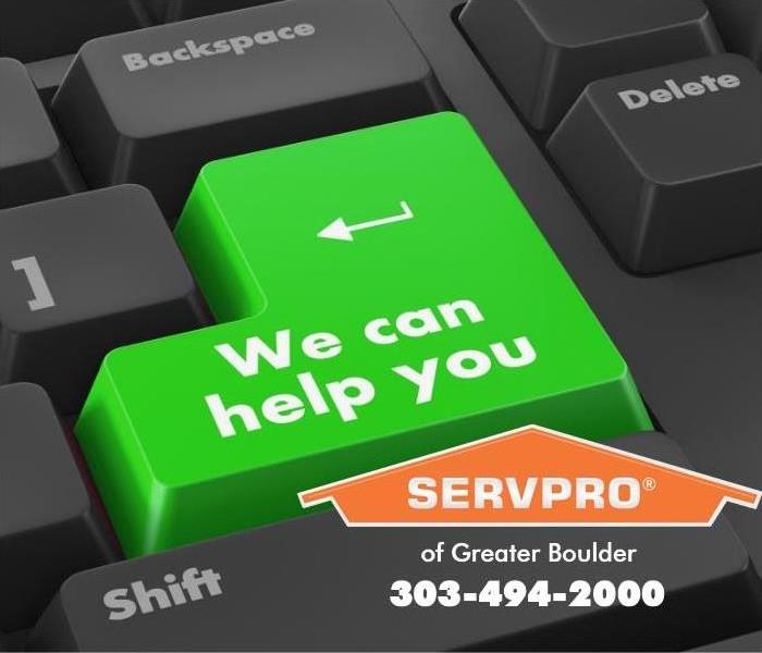 "Computer keyboard with one key stating ""We can help you."""